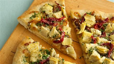 artichoke pizza recipe luscious artichoke heart pizza recipe from pillsbury com