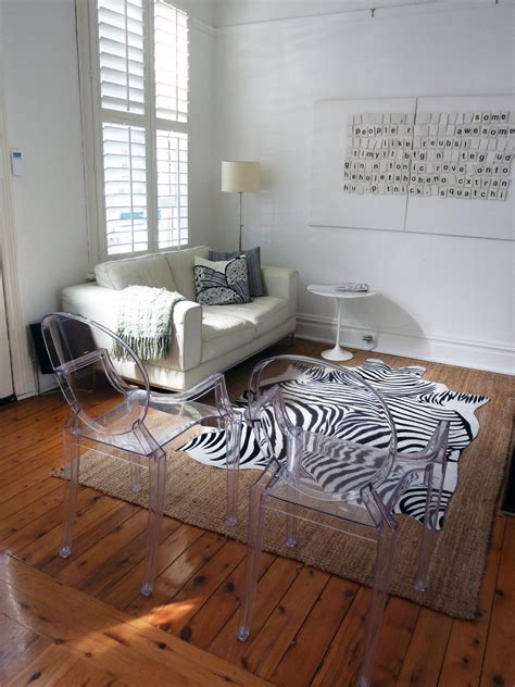 Living Room Rug Photos by White Living Room With Zebra Rug And Ghost Chairs Hgtv