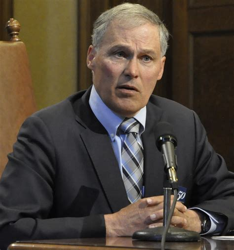 inslee signs budget  vetoes cuts  funds
