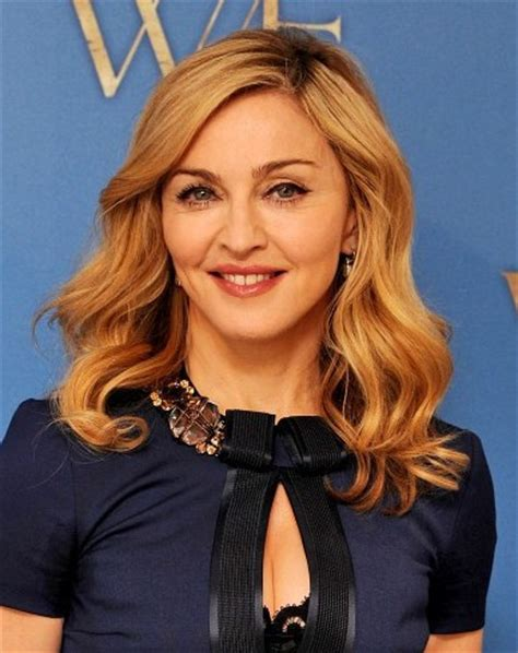 madonna medium wavy hairstyles  blonde hair popular