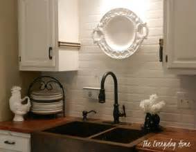 budget painted brick backsplash at the everyday home