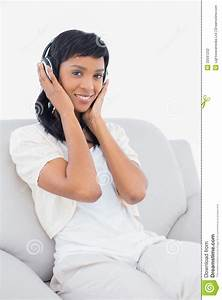 Peaceful Black Haired Woman In White Clothes Listening To ...