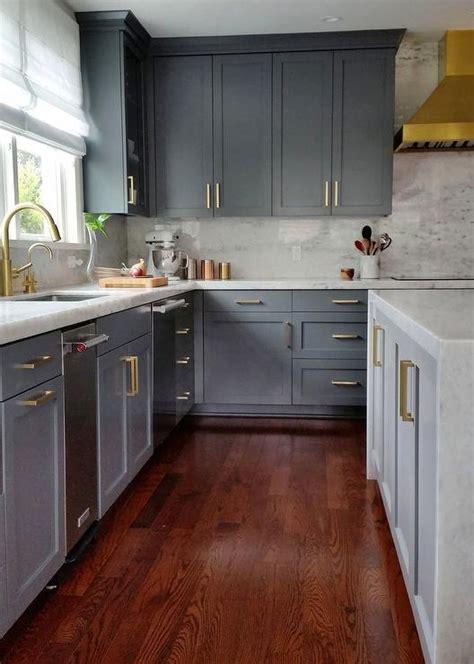 dark grey shaker cabinets gold dome kitchen hood over blue marble striped kitchen