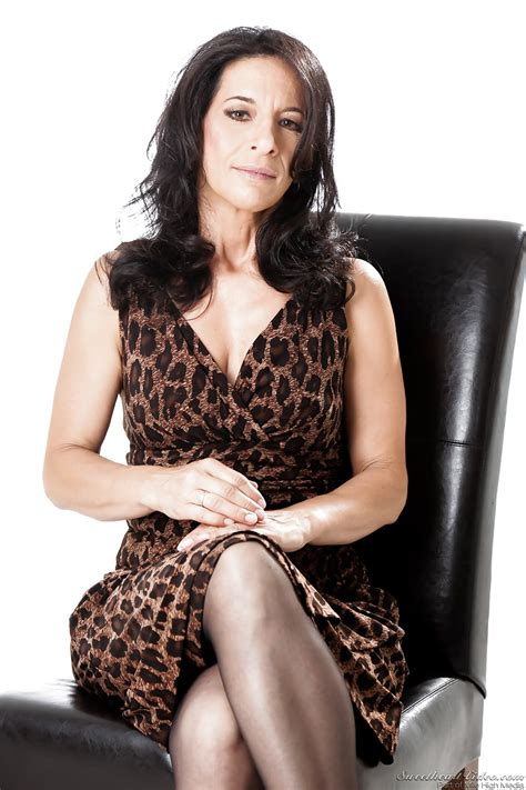 Mature Brunette In Black Stockings Teases Guys Showing