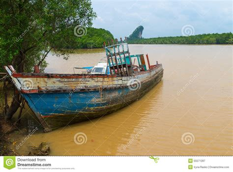 Old Wooden Boat Video by Old Wooden Boat Abandoned And Deteriorating On A Muddy