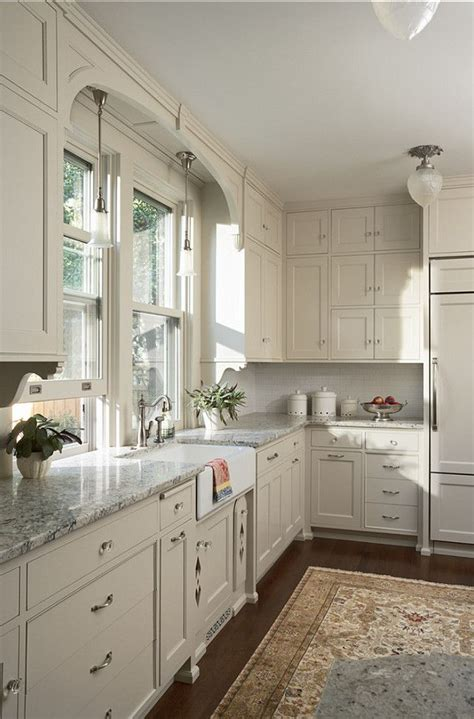 white kitchen cabinets with wood floors white kitchen cabinets gray granite countertops dark 961 | white kitchen cabinets gray granite countertops dark wood floors persian rug kitchen cabinet paint color benjamin moore oc 14 natural cream