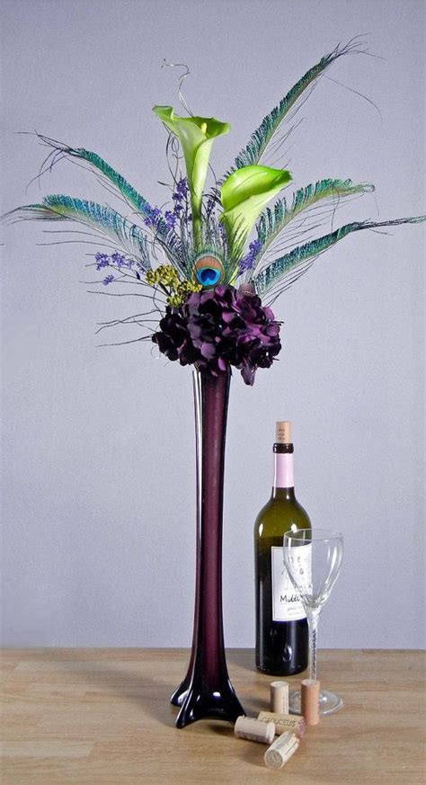 Thin Vase Centerpiece Ideas by Peacock Feathers Green Calla Lilies And Purple Hydrangeas