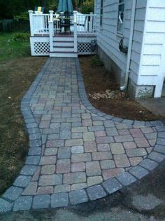 unilock camelot seat wall with unilock camelot paver field and charcoal