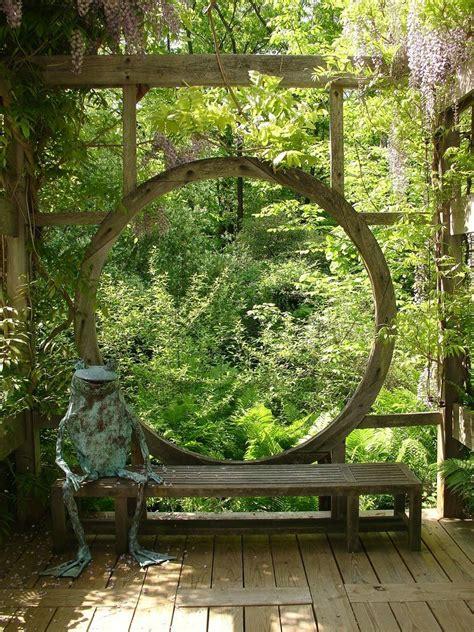 moon gate esque wooden window  deck  karl gercens