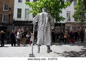 Silver painted street performer in Krakow Poland Stock ...