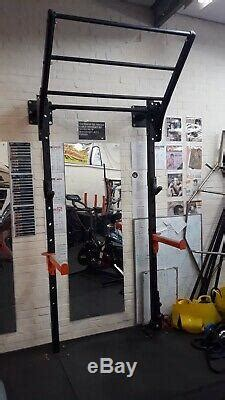 wall mounted squat rack space saving  extras tiered pull  bar