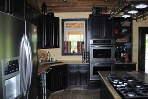 Black kitchen cabinets paint outdoor furniture black for Best brand of paint for kitchen cabinets with glass wall art for sale