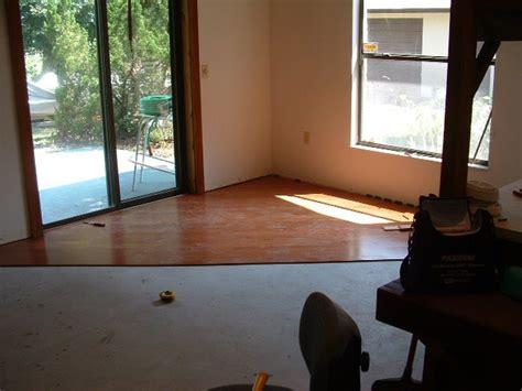 pergo flooring around fireplace laminate flooring fireplace undercutting fireplaces for laminate flooring flooring willow