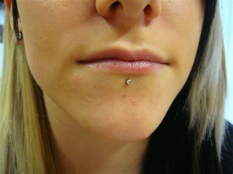 piercing leguan tattoo