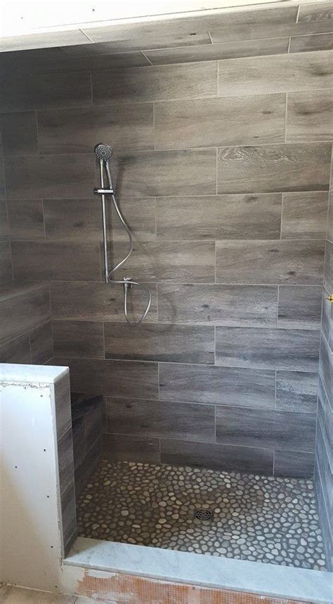 COOL wood grain porcelain shower and river rocks! (Stephen