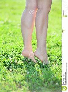 Woman Standing On Tiptoe On Green Grass Royalty Free Stock