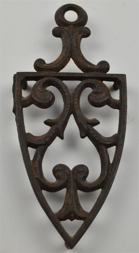 old cast iron vintage cast iron spade design trivet 7 75 quot tall
