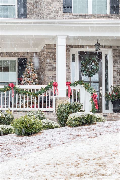 front porch railing decorated   classic christmas