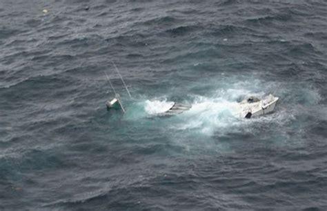 northwest passage  dot  yacht sinks  miles north