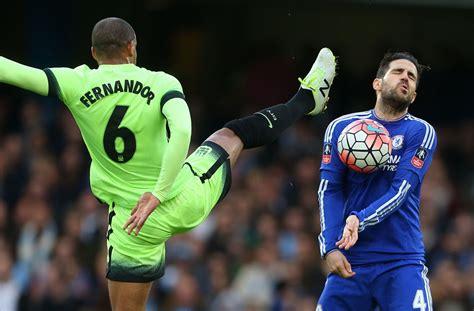 Cesc Fàbregas reacts as Fernando of Manchester City kicks ...