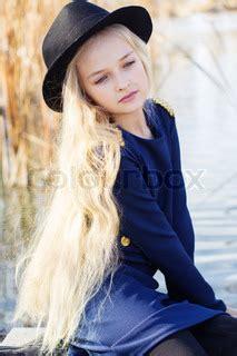 cute smiling girl  blonde hair outdoors