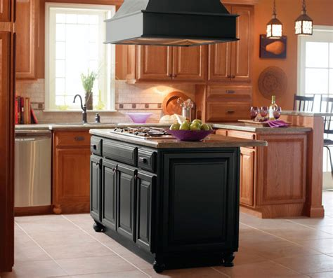 kitchen islands with cabinets light oak cabinets with black kitchen island kemper