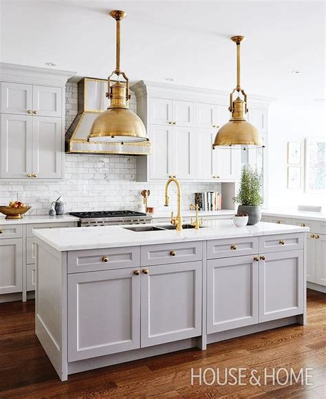 light grey kitchen cabinets with gold hardware gray kitchen island with brass large country industrial