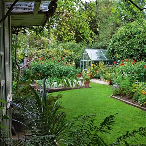 flower garden with greenhouse country cottage garden