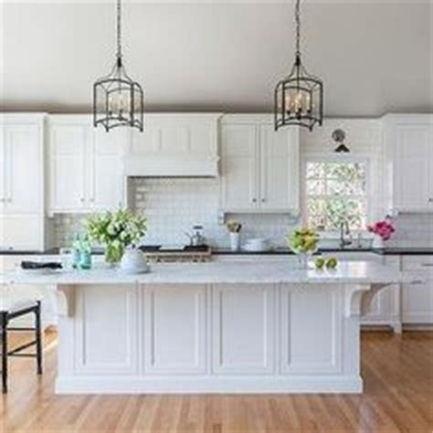 cleaner for kitchen cabinets simple yet handcrafted corbels on the island 7067