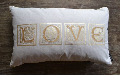 nicole miller embroidered gold tan love pillow