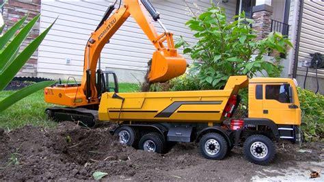 rc adventures  scale earth digger xl excavator   armageddon dump truck youtube