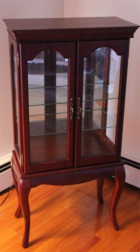 bombay company curio display cabinet cherry finish queen