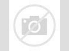 Colourful red and white striped beach hut overlooking the