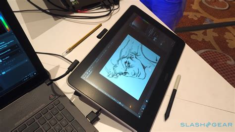 wacom cintiq ces masses hands slashgear