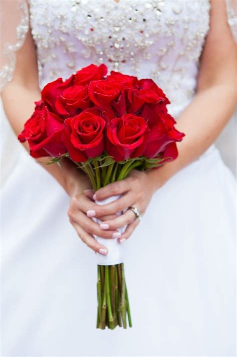 bright red rose bouquet tied  white ribbon