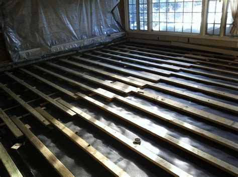 2x4 Sleepers shimmed over Concrete Slab
