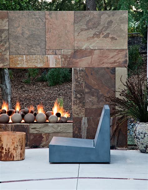outdoor gas fireplace pool rustic with faux