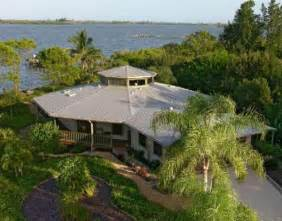 wrap around house plans island style homes