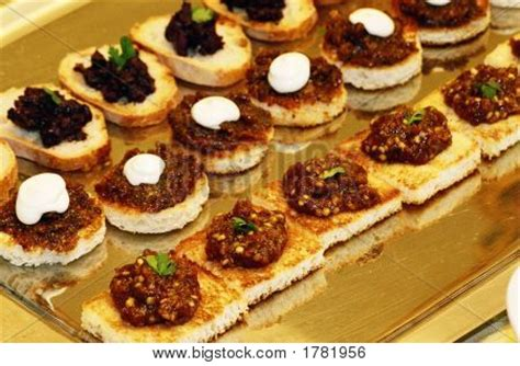 baked canapes tapanade on crostini caviar on freshly baked eggplant fig