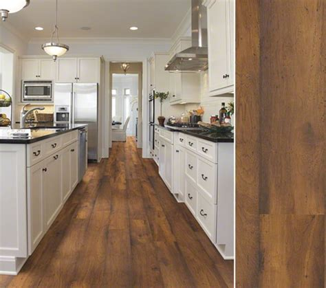 flooded kitchen floor hgtv home flooring by shaw laminate in a hickory visual 3782