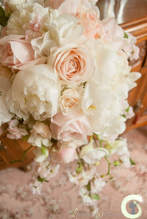 Teardrop Bouquet Of Roses Peonies Blossom And Orchids