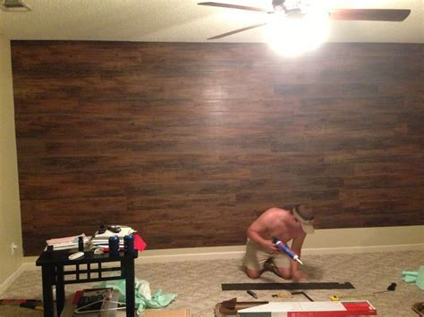 Our master bedroom wall, used stick and peel hard wood
