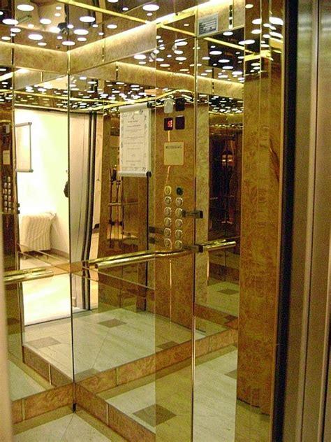cabina ascensore foto cabina ascensore in acciaio oro radica e specchi di