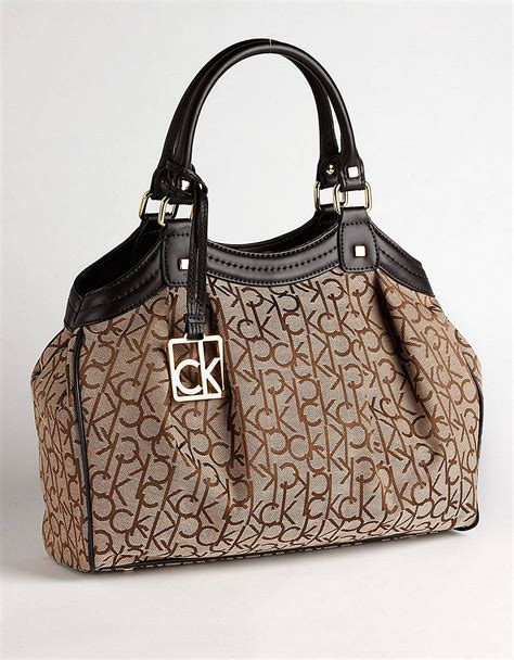 calvin klein hudson monogram satchel bag  brown khaki