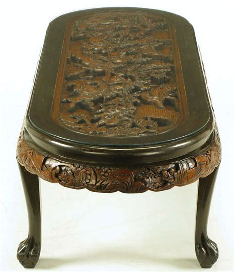 siege table oval coffee table with carved battle