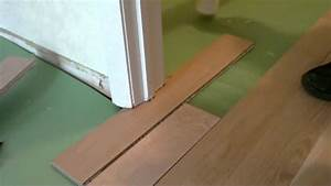 Install floating wood floor under door jambmp4 youtube for How to lay laminate flooring through a doorway