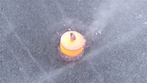 Red Hot Steel Battles a Frozen Lake in a Video of Ice and ...