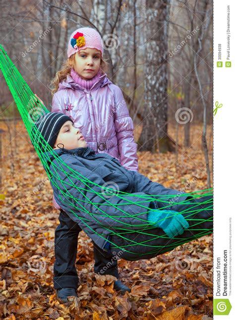 Big Boy Hammock by A Boy With His Relaxing In A Hammock Royalty Free