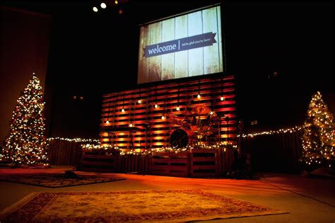 white christmas light projector wrapped in pallets church stage design ideas