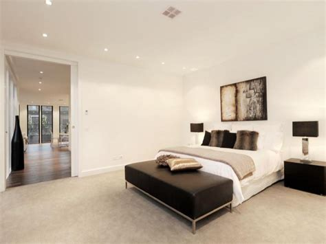 modern bedroom design idea with carpet bi fold doors